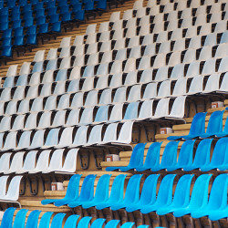 Blue and white plastic stadium seats